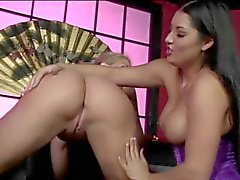Two big titted lesbians share a double ended dildo