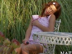 brunette in the jungle plays with her own