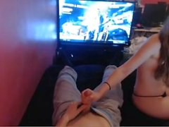 Girl Plays with Guy's Dick while he enjoys video game.