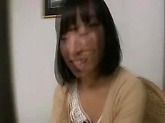 Irresistible Japanese girl with a pretty smile puts on a se
