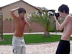 Playful gay boys fooling around in front of the camera outdoor