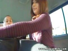 Asian cougar rubbing dicks in car