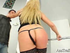 Acrobatic Lia gets ass fucked and double penetrated. The guys jizz all over her ass