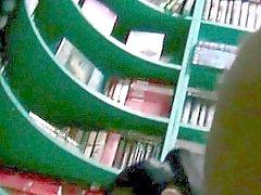 Hidden camera upskirt shot of a sexy brunette visiting a bo