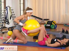 Fitness Rooms Two Lesbian Gym partners workout
