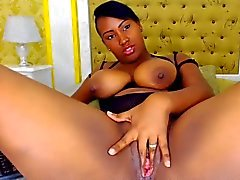 Busty latin ebony girl shows off her pink cunt