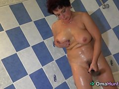 Naughty granny enjoys her body in the bathroom