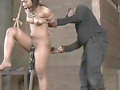 Suspended breast bondage ebony spanked