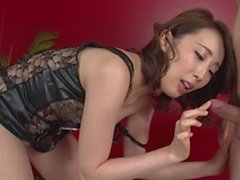 Cute east asian brunette chick kneads and blows cock for cum