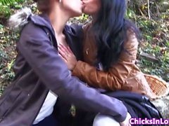Euro lesbian girlfriends outdoors kissing