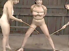 Tied up babe is punished by corporalist for her naughty sins