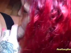 tattooed redhead loves hard gangbang