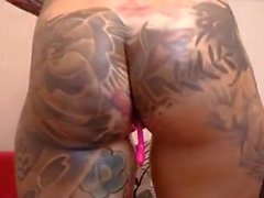Tattooed chick fuking pussy hard with dildo fingering deep