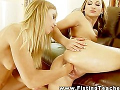 Lesbian loves streching pussy with her fist and toys