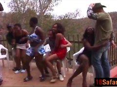 Ebony babes suck dicks on a orgy party