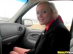 Cute blonde sucks and fucks in a car