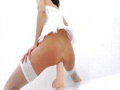 Two monster dildos in her bottom