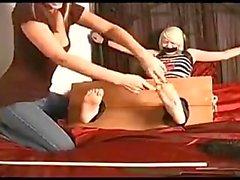 Feet tickled in stocks