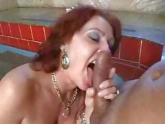 Redhead blows his rod, rides it and gets anal in the pool