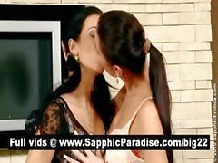 Gorgeous brunette lesbians kissing and fingering pussy and having lesbian love