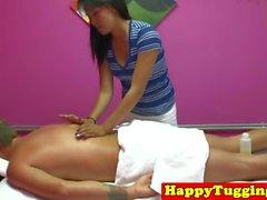 Smalltitted asian masseuse jerking client