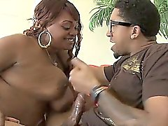 Chunky black babe giving tit job