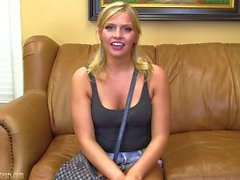 Teen girl on casting couch spreads her pussy