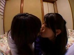 Sexy Oriental girls kiss each other and indulge in intense