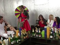 Party girls drinking and stipping a guy