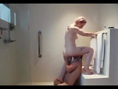 Horny girl with tatoos gets fucked in the gym shower
