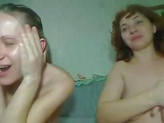 Two crazy girls fist and use a bottle on their pussies on webcam