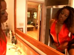 Busty ebony MILF in latex checks herself out and gets her feet licked