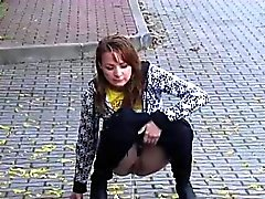 Peachy cunt filmed pissing in public places