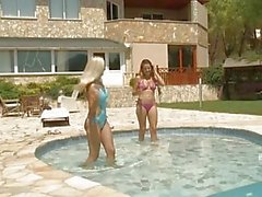 Two hot pornstar babes in bikinies making out in the pool