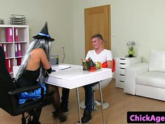 Costumed stockinged agent rides young cock