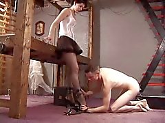 Really mean bondage chicks in latex paddle bound guy's ass