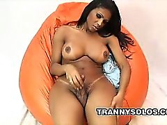Big tit ebony shemale Andreia Oliveira strips off her