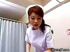 Japanese nurse stripteasing