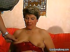 Mature slut in red lingerie gang banging
