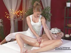 Oiled lesbians tribbing in massage