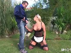 Blonde maid babe blowing her boss in the garden