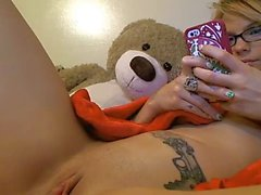 Spreads lips and fingers pussy, inserts anal plug