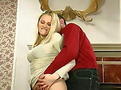 Busty blonde puts on a strapon to fuck her man in femdom clip