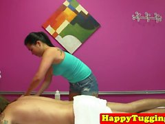 Inked asian masseuse tugging and cocksucking