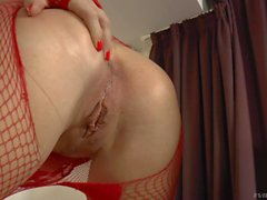 Horny Blonde MILF Lili A in red fishnet pantyhose
