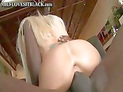 Fake-boobed blonde porn babe gets boinked by a black hunk's penis
