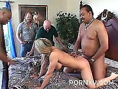 This hardcore threesome features pornstar Laurie taking two dicks from both ends. Laurie Garvey is up for some serious cock stuffing in this clip and brought along his loving husband and let him watch as Laurie stretched her holes by cramming them with hu