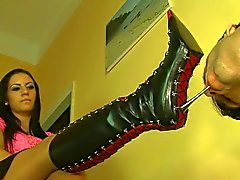 Likking boots shoes of tis nice mistress