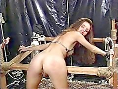 Mature blond dominatrix restrains brunette puma with nipple clips in fortress