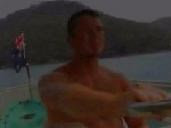 The muscled Australian men fuck on the bow of a ship.